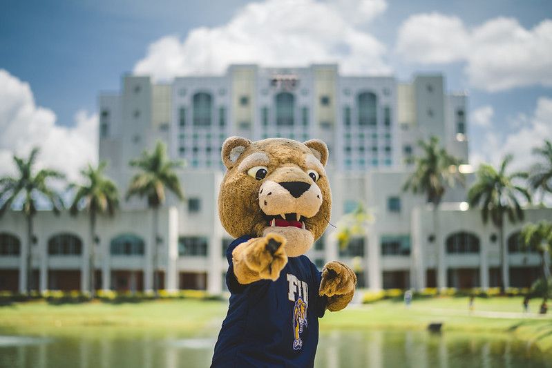 Roary Pointing at the Camera while standing in front of the Green Library